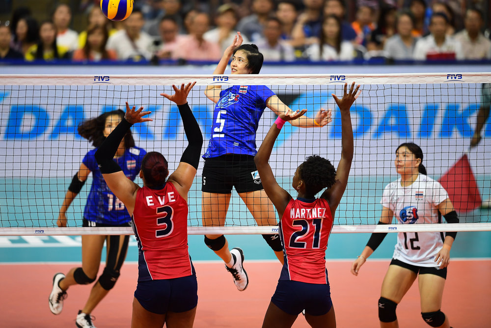 BANGKOK, THAILAND - MONTH 29: Pleumjit Thinkaow (c) of Thailand going for a spike against Team Dominican Republic at the FIVB Volleyball Nation League 2018, Hua Mark Indoor Stadium, Bangkok, Thailand on May 29, 2018. 
