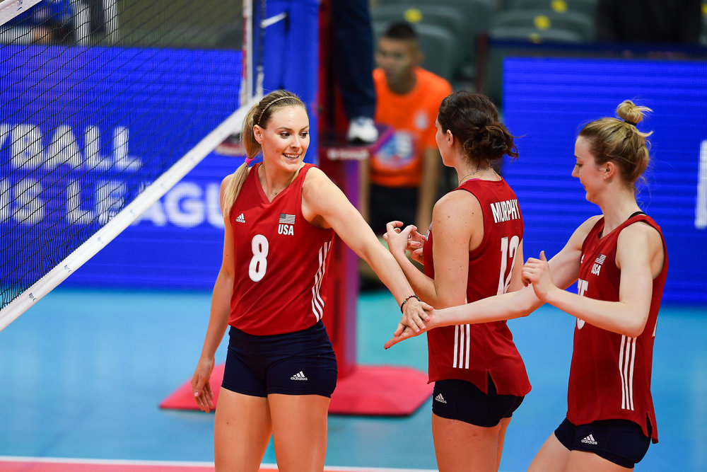 BANGKOK, THAILAND - MONTH 30: Lauren Gibbemeyer of USA giving her teammates Kimberly Hill of USA a high five during their match against Team Dominican Republic at  the FIVB Volleyball Nation League 2018, Indoor Stadium Huamark, Bangkok, Thailand on May 30, 2018. 