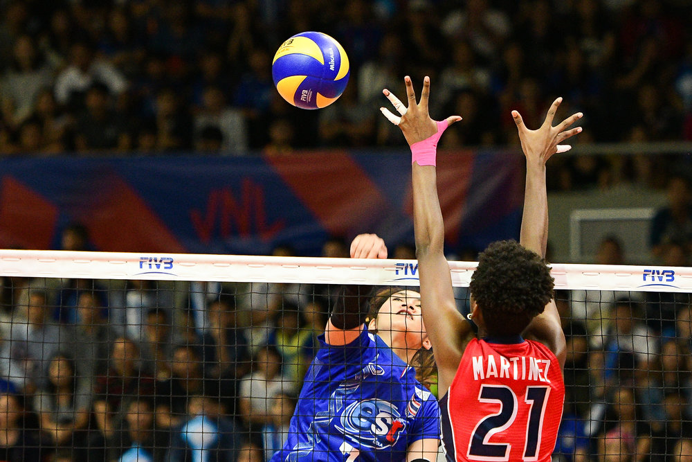 BANGKOK, THAILAND - MONTH 29: Hattaya Bamrungsuk of Thailand spiking against Jineiry Martinez of Dominican Republic during the FIVB Volleyball Nation League 2018, Hua Mark Indoor Stadium, Bangkok, Thailand on May 29, 2018. 