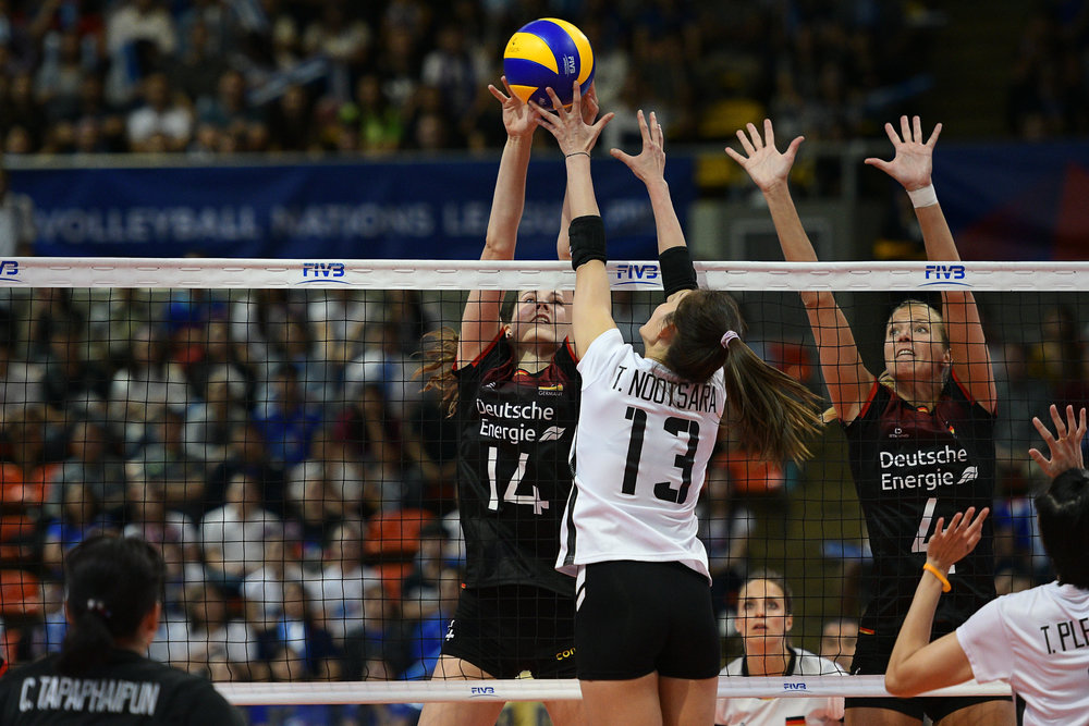 BANGKOK, THAILAND - MONTH 30: Marie Sch�lzel of Germany blocking against Nootsara Tomkom of Thailand  during the FIVB Volleyball Nation League 2018, Indoor Stadium Huamark, Bangkok, Thailand on May 30, 2018. 
