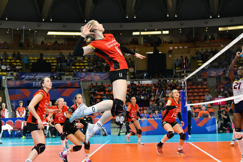 BANGKOK, THAILAND - MONTH 31: Louisa Lippmann of Germany flying high for a super spike during the FIVB Volleyball Nation League 2018, Indoor Stadium Huamark, Bangkok, Thailand on May 31, 2018. 
