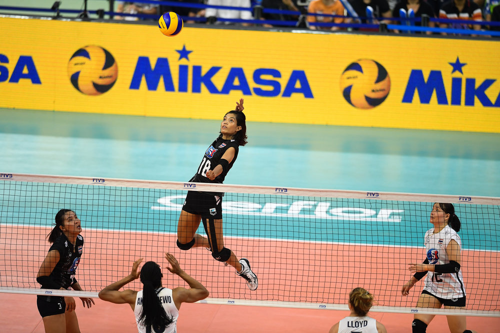 BANGKOK, THAILAND - MONTH 31: Ajcharaporn Kongyot of Thailand going for a spike against Team USA during the FIVB Volleyball Nation League 2018, Indoor Stadium Huamark, Bangkok, Thailand on May 31, 2018. 