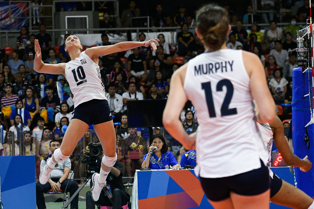 BANGKOK, THAILAND - MONTH 31: Jordan Larson (c) of USA going for a spike against Team Thailand during the FIVB Volleyball Nation League 2018, Indoor Stadium Huamark, Bangkok, Thailand on May 31, 2018. 