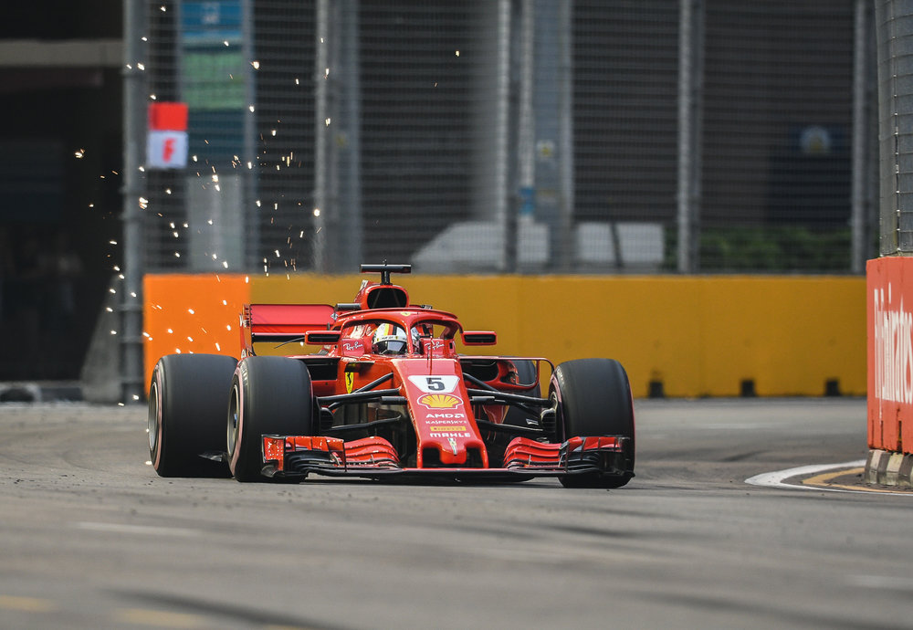 SINGAPORE - SEPTEMBER 15: Sebastian Vettel (5) of Scuderia Ferrari exiting Turn 15 during FP3 at the F1 Singapore Airlines - Singapore Grand Prix 2018, Marina Bay Street Circuit, Singapore on September 15, 2018. 