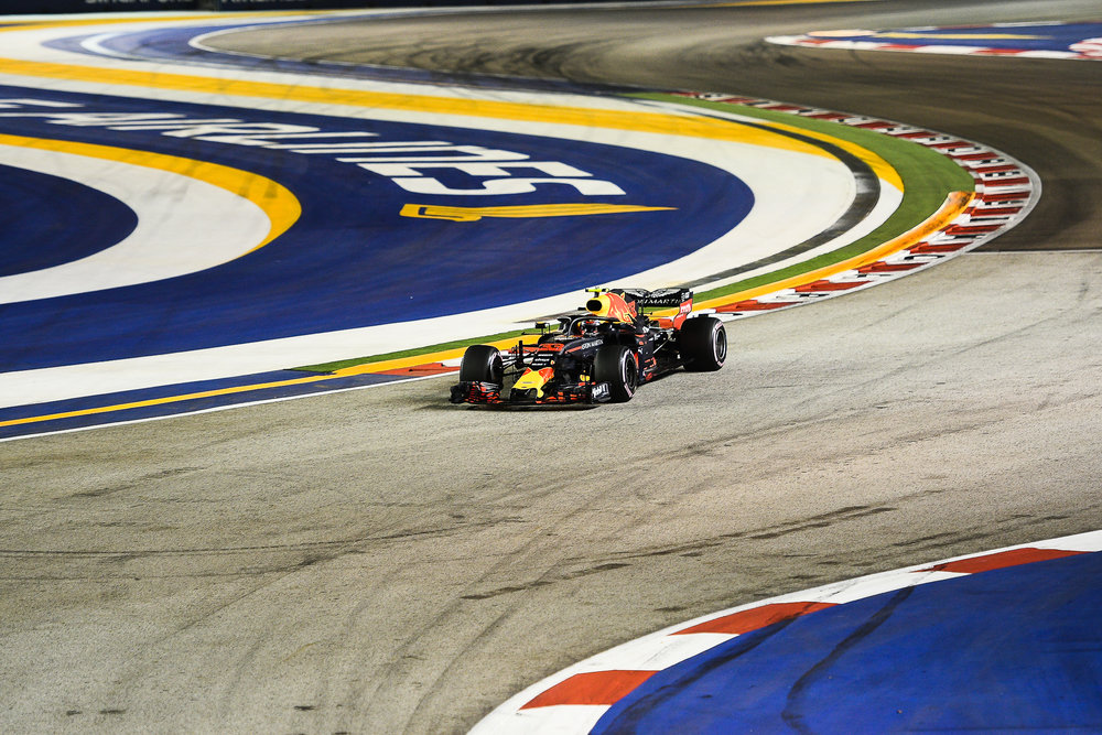 SINGAPORE - SEPTEMBER 15: Max Verstappen (33) of Aston Red Bull Racing exiting Turn 2 during the Qualifying Race at the F1 Singapore Airlines - Singapore Grand Prix 2018, Marina Bay Street Circuit, Singapore on September 15, 2018. 