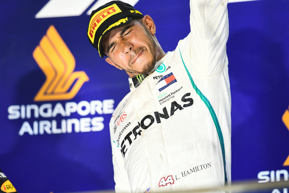 SINGAPORE - SEPTEMBER 16: Lewis Hamilton (44) of Mercedes AMG Petronas Motorsport reaction on the podium with the Trophy after the Race at the F1 Singapore Airlines - Singapore Grand Prix 2018, Marina Bay Street Circuit, Singapore on September 16, 2018. 