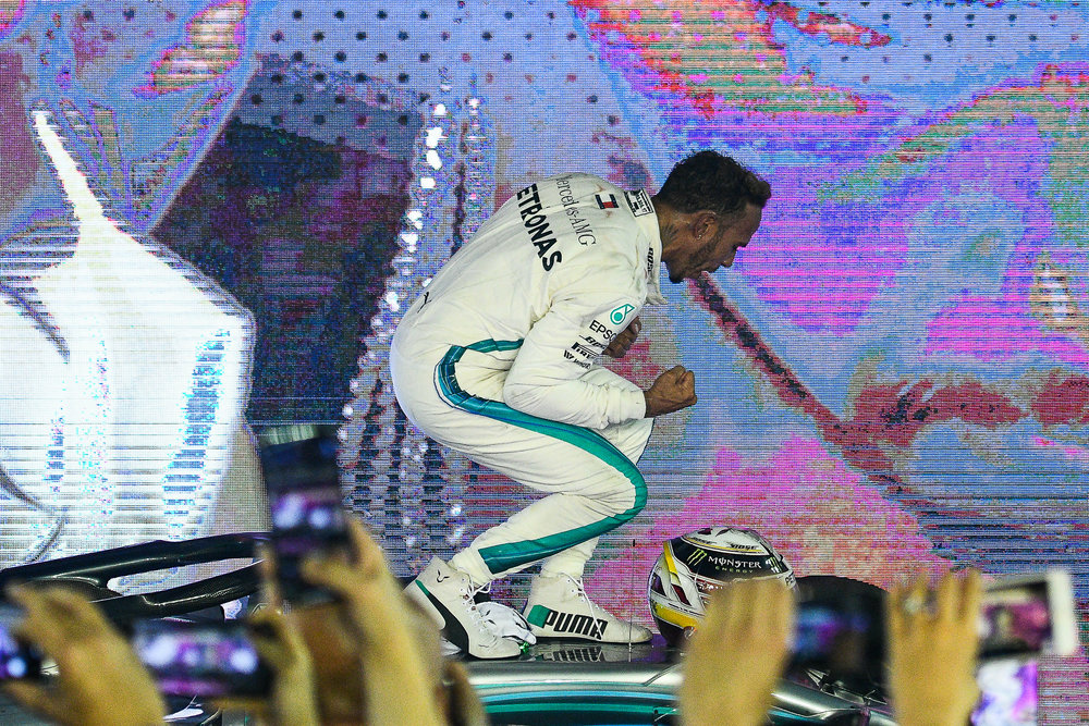 SINGAPORE - SEPTEMBER 16: Lewis Hamilton (44) of Mercedes AMG Petronas Motorsport reaction in Parc Ferme after winning the F1 Singapore Airlines - Singapore Grand Prix 2018, Marina Bay Street Circuit, Singapore on September 16, 2018. 