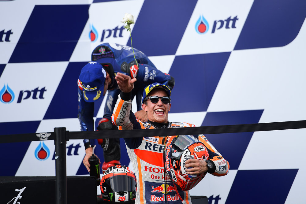 THAILAND - OCTOBER 07: Marc Marquez (93) of Spain and Repsol Honda Team throwing a rose towards the grandstand on the podium at the Inaugural MotoGP PTT Thailand Grand Prix 2018, Chang International Circuit, Thailand on October 07, 2018. 