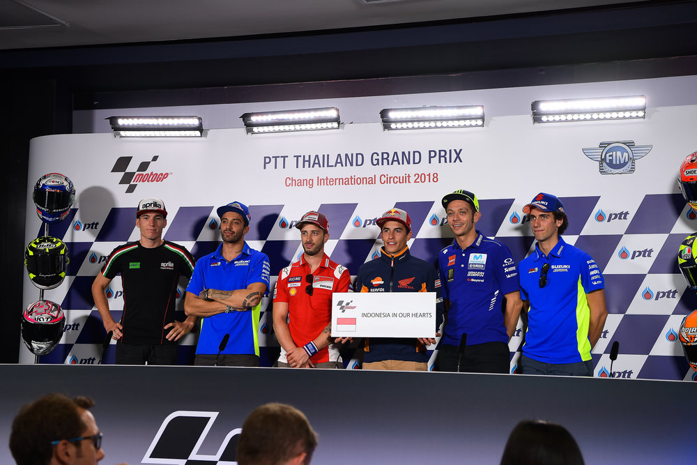 THAILAND - OCTOBER 04: (L-R) Aleix Espargaro (41) of Spain and Aprilia Racing Team Gresini, Andrea Iannone (29) of Italy and Team SUZUKI ECSTAR, Andrea Dovizioso (4) of Italy and Ducati Team, Marc Marquez (93) of Spain and Repsol Honda Team, Valentino Rossi (46) of Italy and Movistar Yamaha MotoGP, Alex Rins (42) of Spain and Team SUZUKI ECSTAR during Pre-Event Riders Press Conference at the MotoGP PTT Thailand Grand Prix 2018, Chang International Circuit, Thailand on October 04, 2018. 