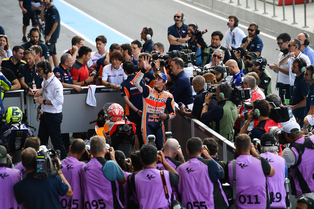 THAILAND - OCTOBER 06: Marc Marquez (93) of Spain and Repsol Honda Team in Parc Ferme after qualifying waving at the fans up on the grandstand at the MotoGP PTT Thailand Grand Prix 2018, Chang International Circuit, Thailand on October 06, 2018. 