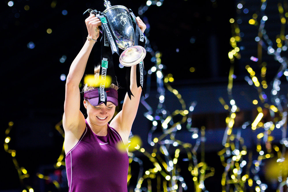 SINGAPORE - OCTOBER 28: Elina Svitolina of Ukraine hoisting the Billie Jean King Trophy after winning her Singles Championship Match at the 2018 BNP Paribas WTA Finals Singapore presented by SC Global, Singapore Indoor Stadium, , Singapore on October 28, 2018. 