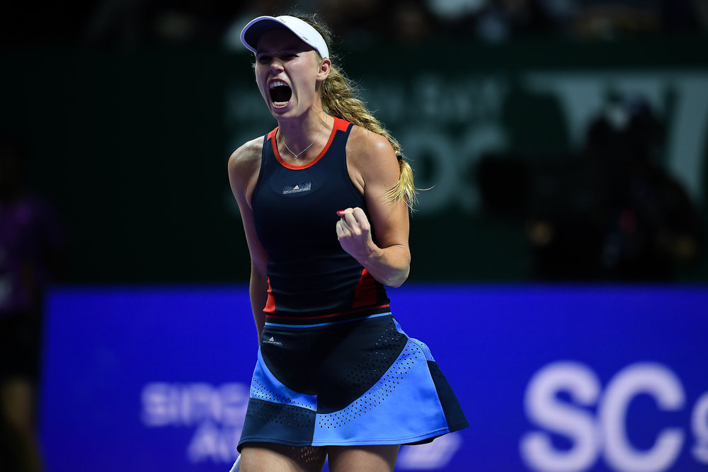 SINGAPORE - OCTOBER 25: Caroline Wozniacki of Denmark reaction during her match against Elina Svitolina of Ukraine on Day 5 of the 2018 BNP Paribas WTA Finals Singapore presented by SC Global, Singapore Indoor Stadium, , Singapore on October 25, 2018. 