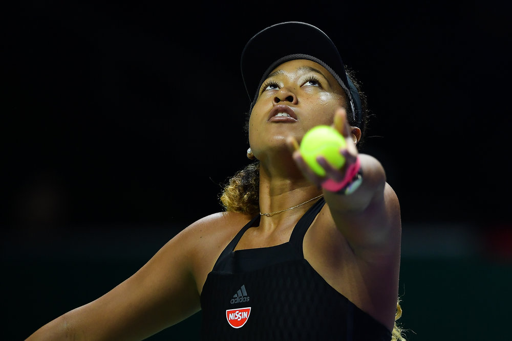SINGAPORE - OCTOBER 26: Naomi Osaka of Japan serving during her match against Kiki Bertens of Netherlands on Day 6 of the 2018 BNP Paribas WTA Finals Singapore presented by SC Global, Singapore Indoor Stadium, , Singapore on October 26, 2018. 