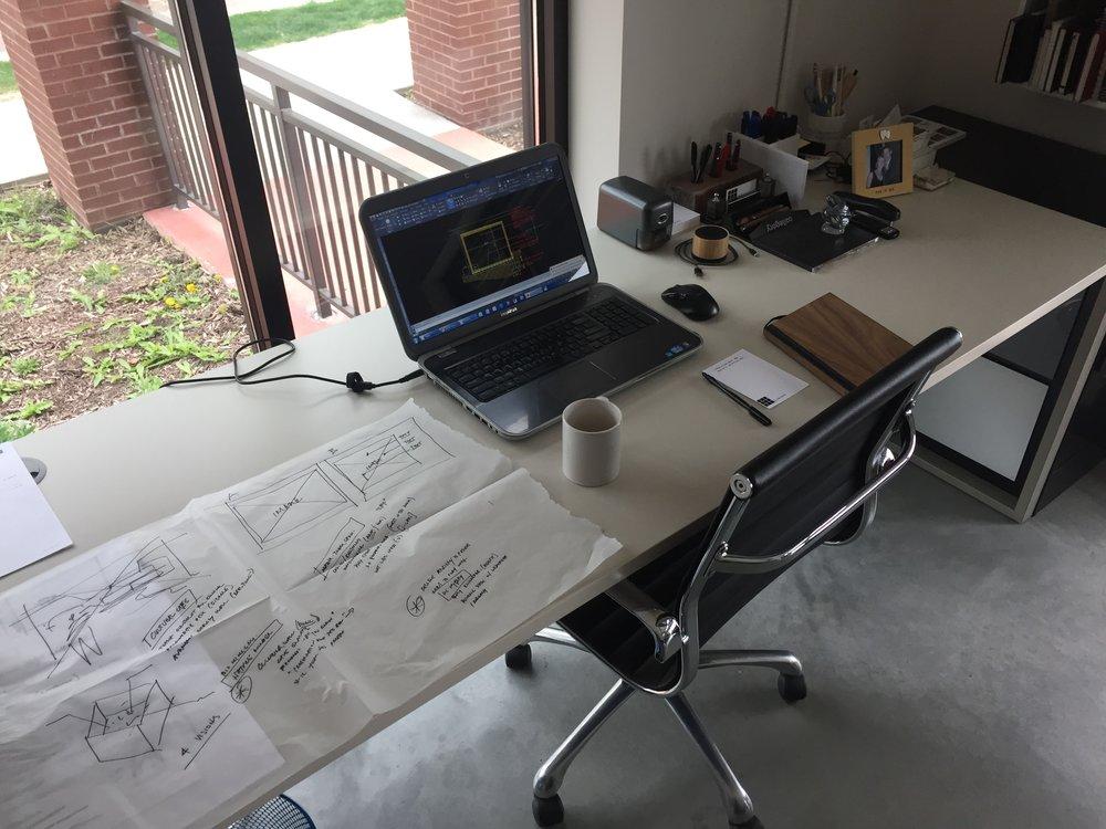 Desk of Adam Ferrari, Architect at 9.square.