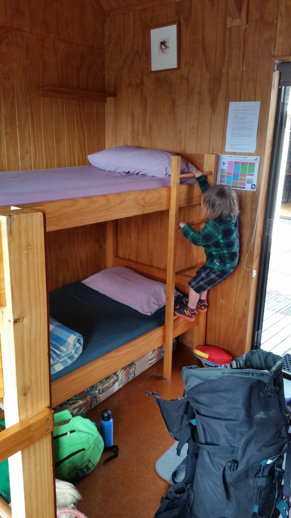 Luke trying to lay claim to the top bunk