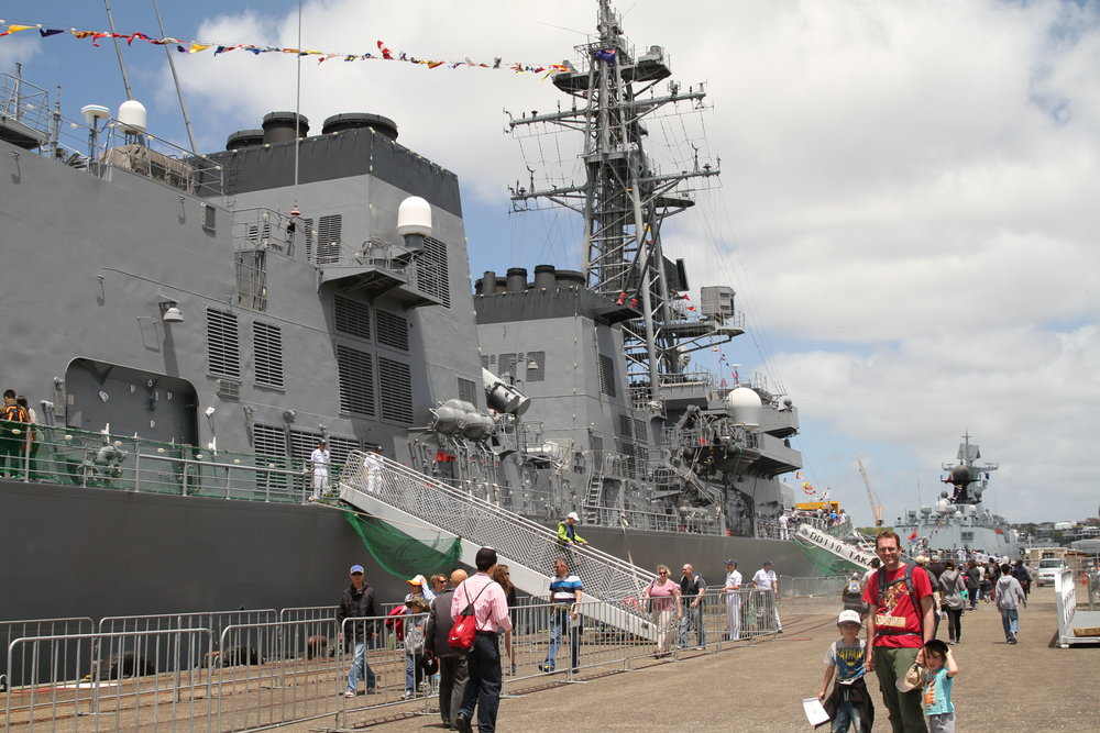 The large JDS Takanami, destroyer, with the Chinese frigate in the distance.