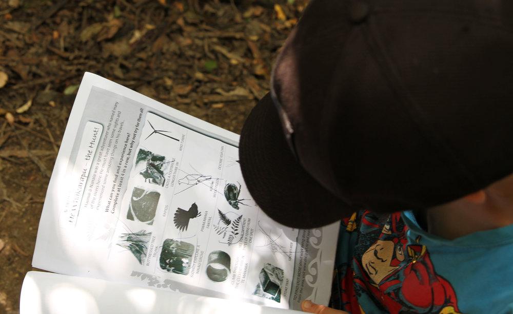 Robin filling in his Kiwi Ranger booklet.