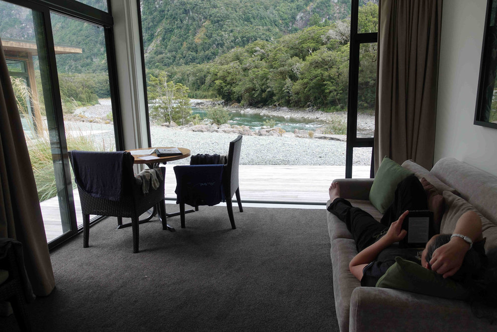 Julianne relaxing after the Milford Track is our lovely riverside chalet