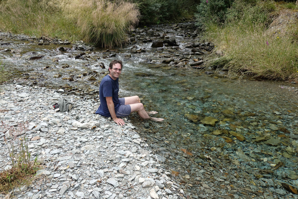 Relaxing in feet in the river at the end of the day - very cold!