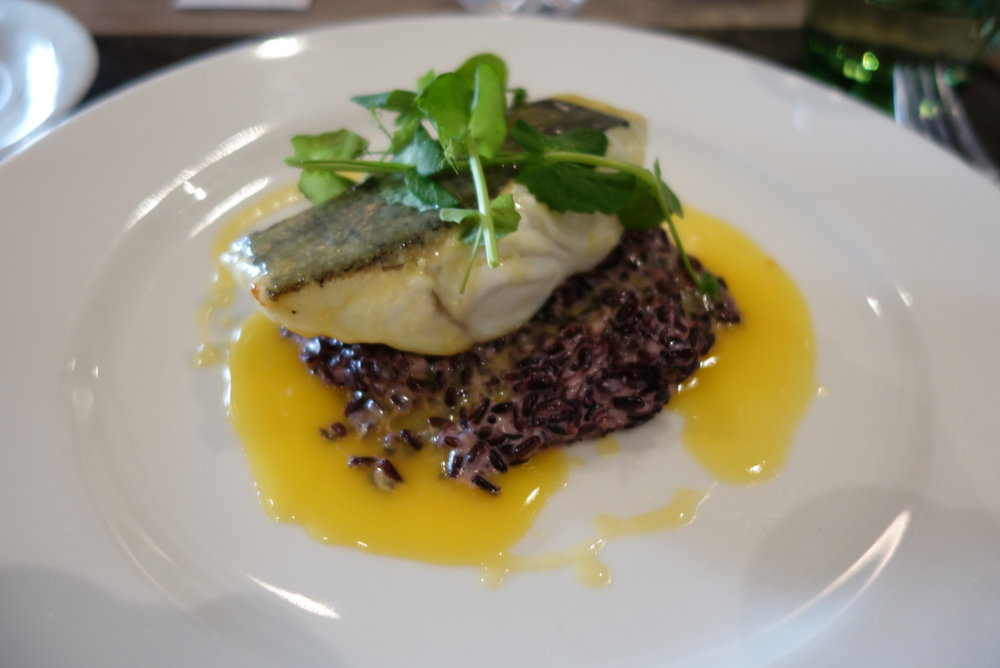 Fish, black rice and orange butter