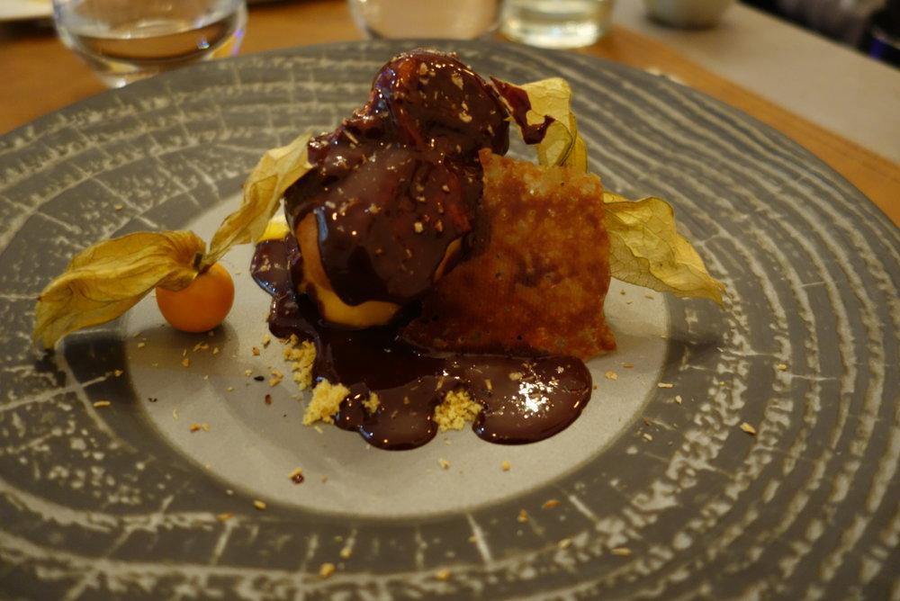 Profiterole with homemade mango ice cream and chocolate sauce