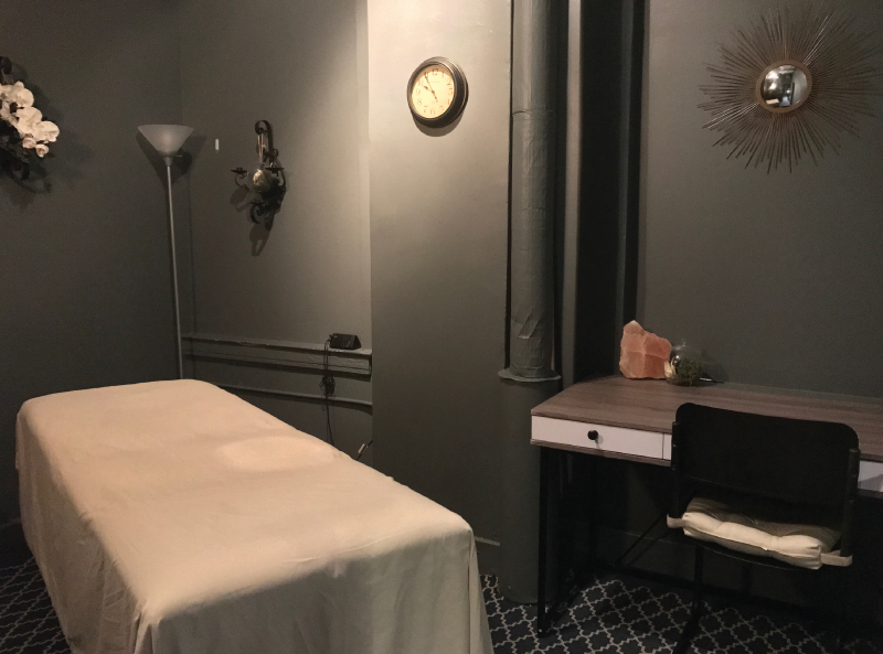 ROOM 5   This Room Features the Following:  - 11.5' X 8' of space  - Desk, Massage Table, and Shelving  - Room is ideal for those who use a    massage table as their primary    treatment setup.