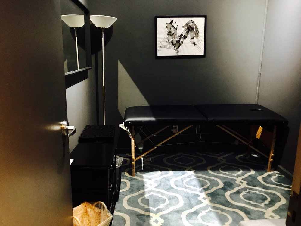 ROOM 15 - This Room Features the Following:  - 8' x 10' of space - Desk & Chair - Massage table