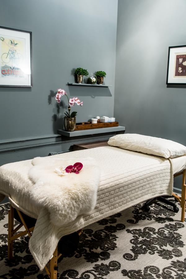 ROOM 14 - This Room Features the Following:    - 11.5' X 8' of space    - Desk, Massage Table, and Shelving    - Room is ideal for those who use a massage table as their primary treatment setup.