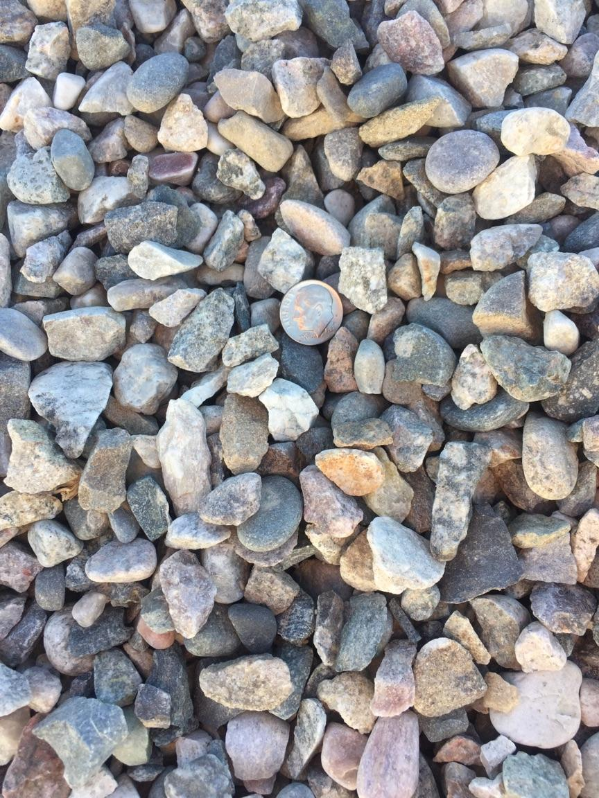 """1/2"""" Round Round rock used for drainage backfill, mixing concrete and landscaping"""
