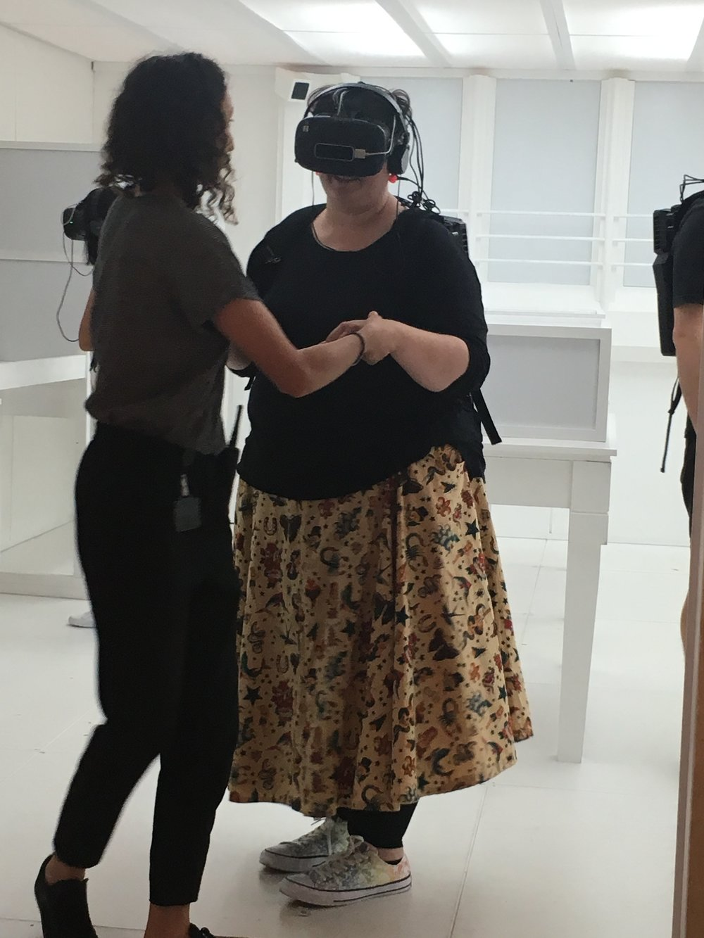 Nicola at Matt Collishaw show in full VR gear and wearing that tricky pattern matched skirt I made