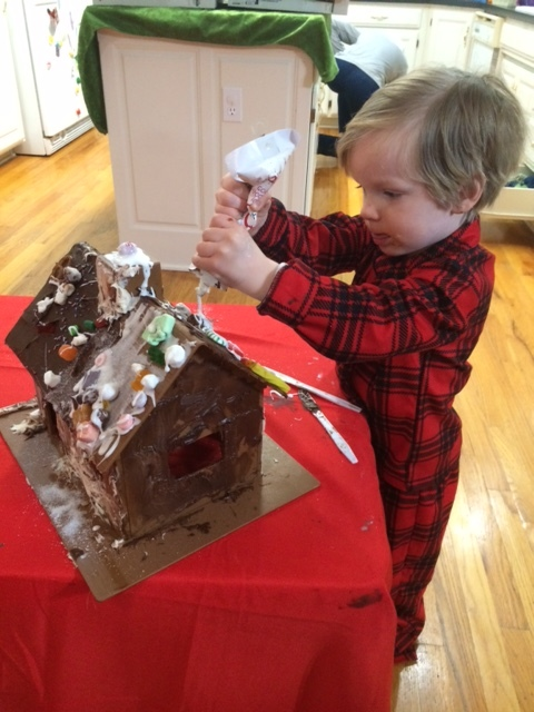 My 3-year-old, hard at work on his house that just oozes the holiday spirit.