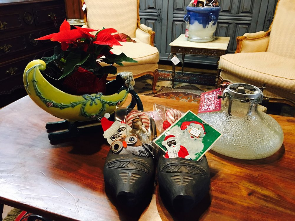 One of a kind 1920's European Glass Christmas Stand, French Majolica Sleigh and Handcarved wooden shoes that are perfect for St. Nick to stuff full of goodies! Come shop Burns Antik Haus for unique gifts for all your holiday needs!!! 2195 Calder Ave. Beaumont, TX 77701, 409.835.3080