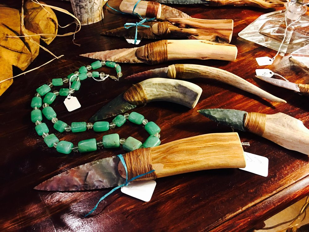 Cool gift idea! Flint stone letter openers with wood or naturally shed horn handles $36-49. Each has its own personality! Glass beads $65 and glass perfume bottles $36. We can help you find that perfect gift!