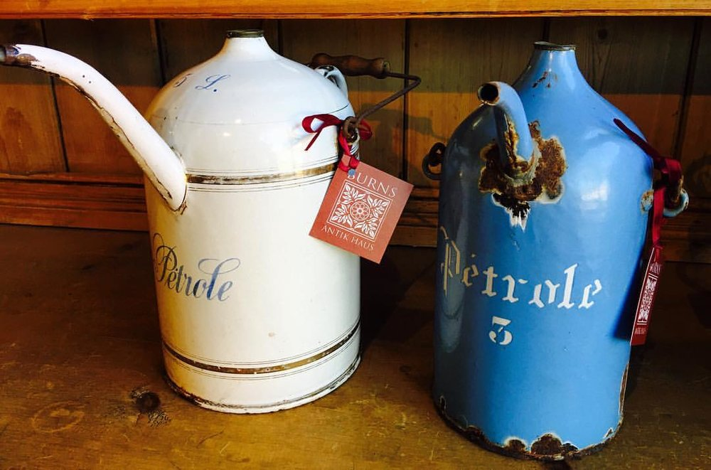 "For the oil man in your life... French ""petrole"" oil cans in enamel... circa 1930s. A rare find! $120 & $175  2195 Calder Ave, Beaumont, TX 77701, 409.835.3080"