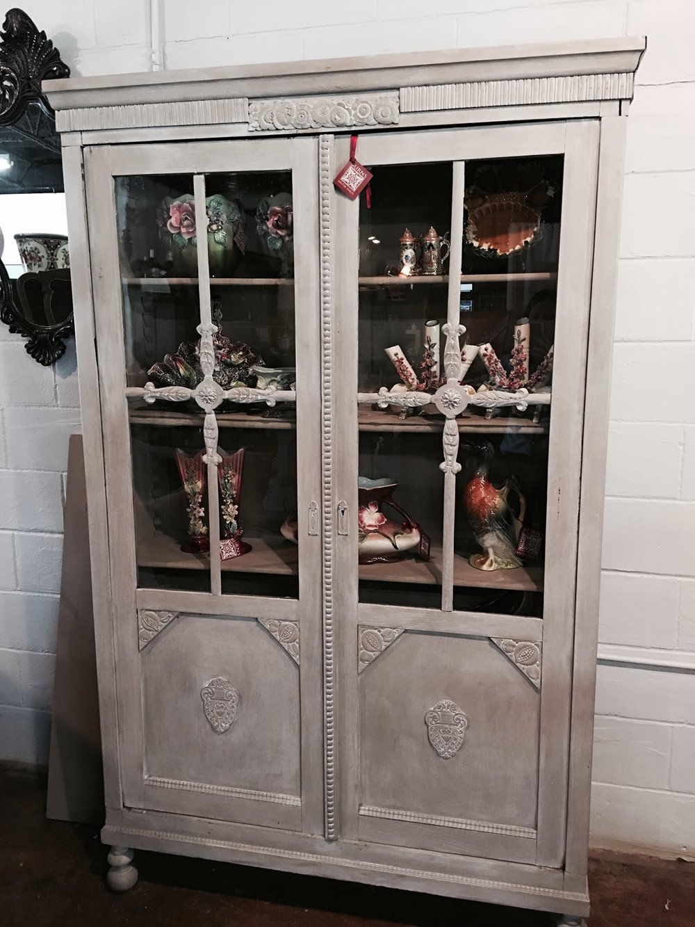 Before and After of a English, circa 1920-30, library or china cabinet. Painted with Maison Blanche chalk paint in Pecan and waxed with Lime wax in white!!! Come check it out and all of our new Maison Blanche paint products! 2195 Calder Ave, Beaumont Tx, 77701, 409.835.3080.  #chalkpaint   #burnsantikhaus   #vintage