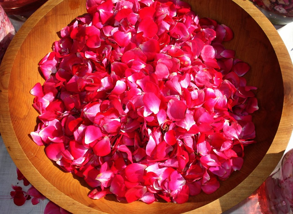 Roses in wooden conjure bowl.