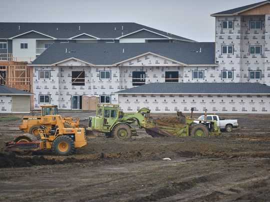 Construction takes place in front of Graystone Apartments, Thursday, Oct. 5, in Sioux Falls. This lot in front of Graystone Apartments will be for shopping centers and parking lots near the apartment complex. (Photo: Briana Sanchez / Argus Leader)