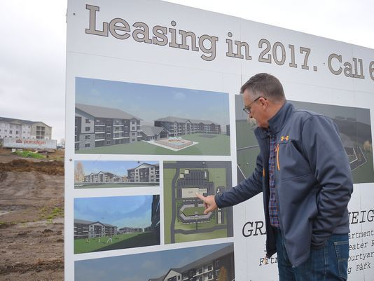 Joel Dykstra, developer for RMB associates, talks about the layout of Graystone Apartments, Thursday, Oct. 5, in Sioux Falls. Half of the apartments are finished and the other half are under construction. As of October 330 apartments are filed.(Photo: Briana Sanchez / Argus Leader)