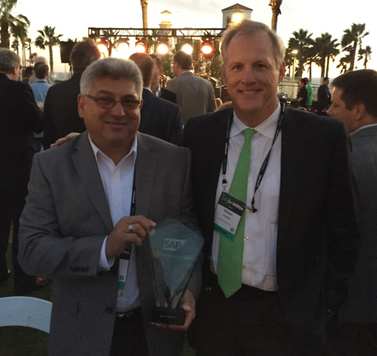 Victor Bulerez, IT Director and Bill Clayton, VP of Customer Care Operations from Reliant Energy receive the SAP Customer Engagement Award for 2016
