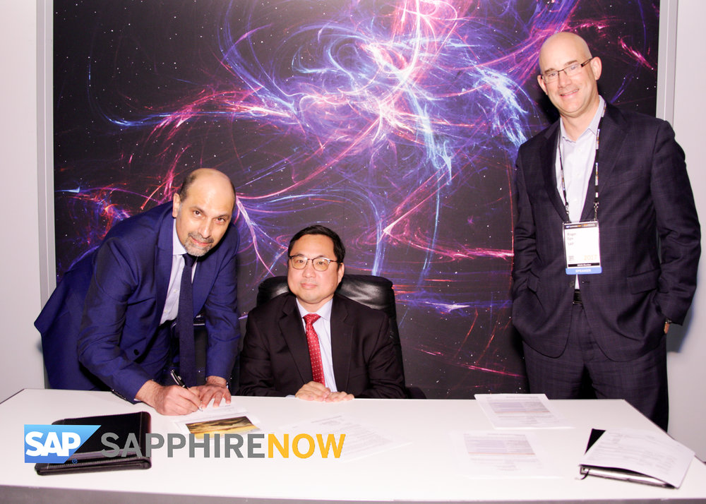 Bin Yu, Utegration's President and CEO signs contract with Sal Laher, SAP's Global COO S4 Cloud & Roger Egle, SAP's Account Executive