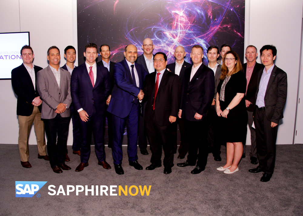 The Utegration team celebrating the contract signing at Sapphire