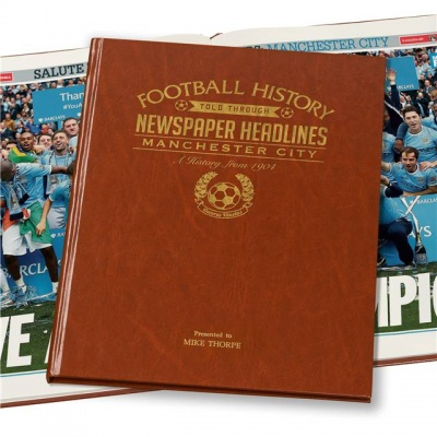 Historic Football Headlines - I bought this recently, and it's pretty cool. Black,white and colour images dating from 1904 to present day, bound together in an A3 leather book. This gift is only suitable for true fanatics of a team.The sheer detail and content is vast. Worth it for someone who wants to relive days gone by of their favourite team.£44.99