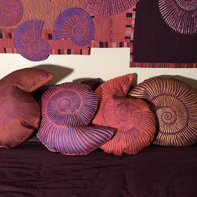 Silk ammonite pillows are delicious!#artpillows #ammonites#quilted #fiberarts #silkpillows #silk #decorativepillows #bedart #sofaart