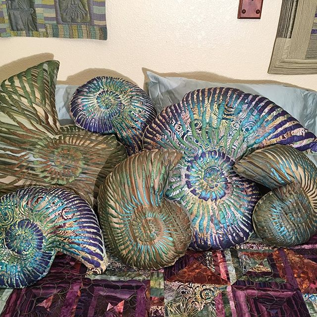 Lovely ammonite pillows. Hand painted and heavily machine quilted. Available at kimlacyfiberarts.etsy.com. #sofaart #bedart #decorativepillows #ammonitepillows #ammonites #ammoniteart #fossilart