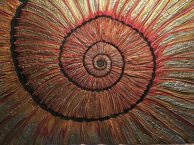 Russian Ammonite quilt just finished. Love this quilt! #paleoart #ammonites #artquilts #ammonitequilts #ammoniteart #fossilart