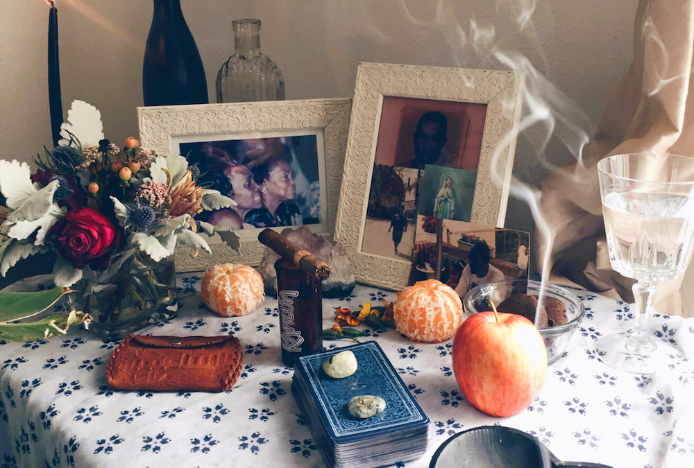 Ancestor altars are a way of honoring our loved ones. Some view the spaces as places of rememberance. Others view ancestral altars as a way to speak with ancestors directly and offer them the comforts of the living, such as food.