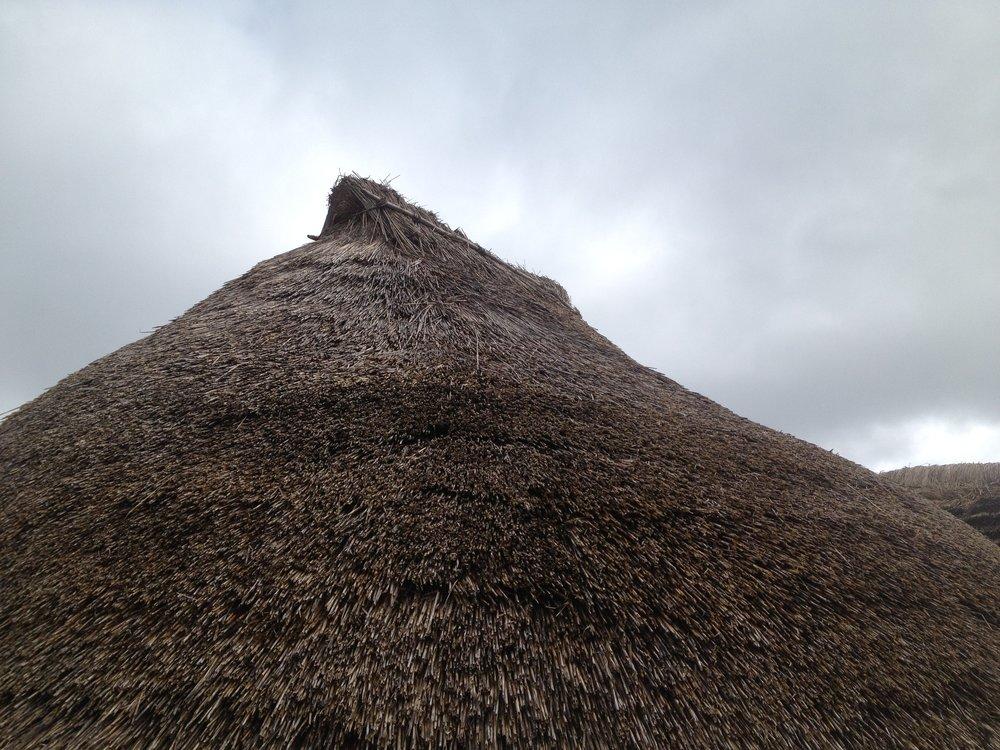 Stonehenge, thatched roof shaped like a mountain