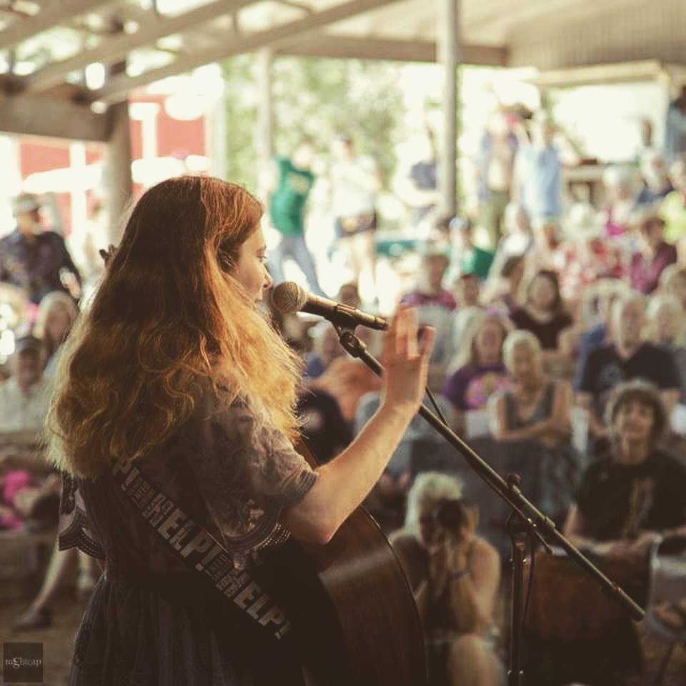 Teghan Devon performing as a New Folk Finalist at the Kerrville Folk Festival (Picture by Ayla Marie Rector)