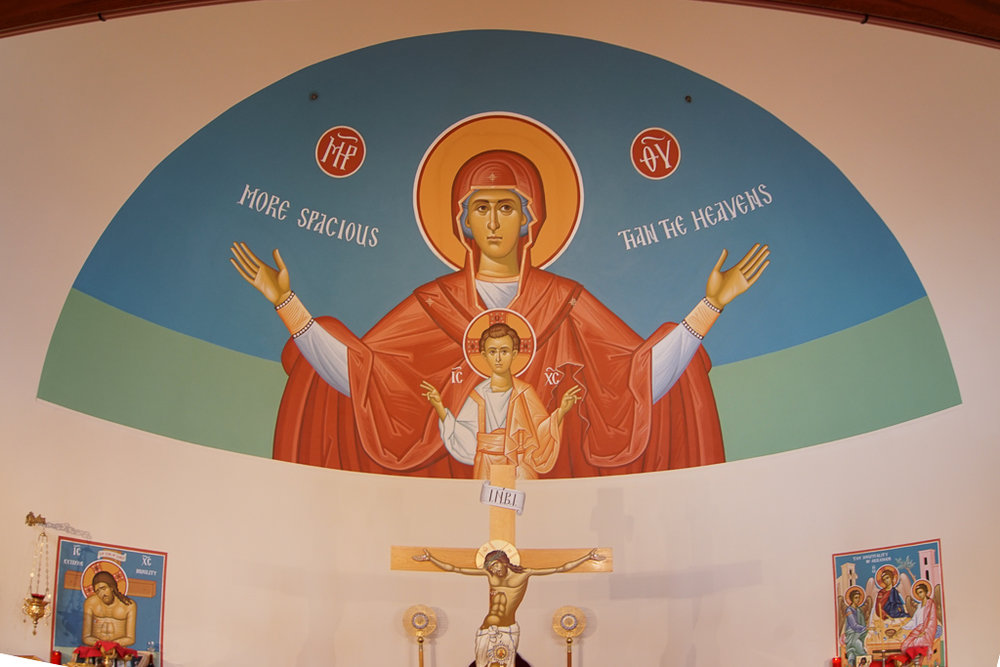 "Mary the Theotokos (""God-bearer"") above the altar. Mary, through her obedience to God and her infilling of the Holy Spirit, is considered to be the prototype for all Christians."