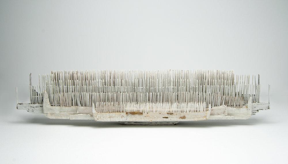 "seven combs , wood, linen, feathers, nails, milk paint, 7.5""x32""x4.5"", 2017"